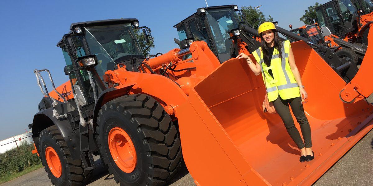 Charlotte Baxter in Wheel loader bucket